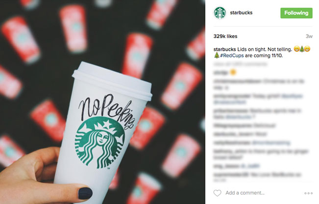 "63701ac57 ... teasing Starbucks fans with the mystery of this year's design.  Starbucks allowed fans to preview the cups by ""unwrapping"" them on their  Instagram Story."